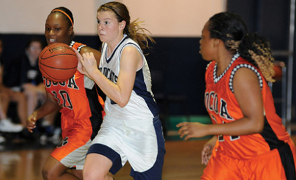 Junior Lydia Kline takes on two Cocoa High School defenders in a 2012 game.