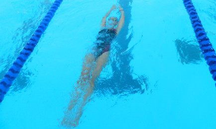 Girls' swimming loses to district rival