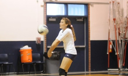 Erica Lobmeyer, 10, returns a warmup serve in a junior varsity game from 2012.