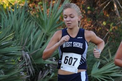 Senior Lexie Krehbiel runs in a cross country meet from 2012