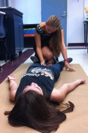 Anatomy student Michelle Smith, 12, traces classmate Erica Denni, 12, to illustrate the regions of the body.