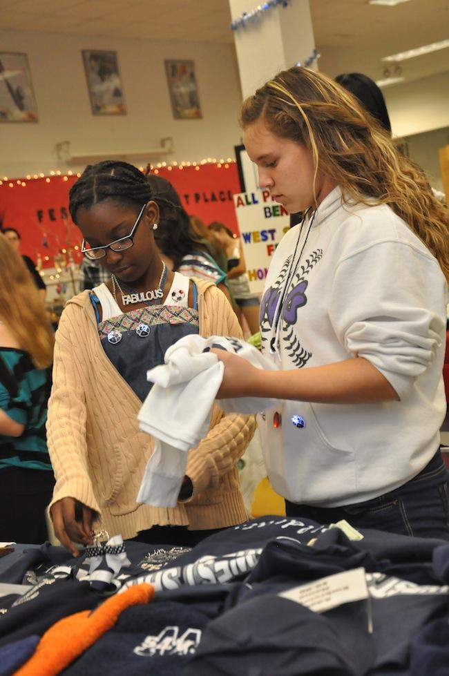 Eighth-grader Yolette Estimable and a friend shop at last year's Festivus Marketplace in November.