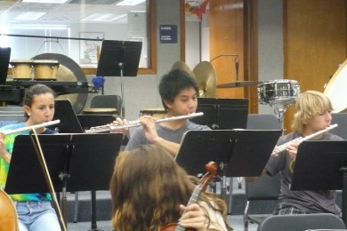 During pit practice, Wind Ensemble member and junior Kevin Baylen plays the flute.