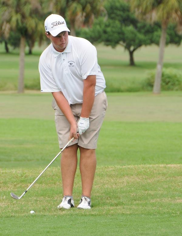 Sophomore Richard Darnell lines up a shot at Crane Creek Golf Course on Monday.