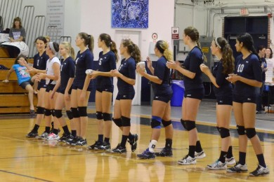 Volleyballers throw candy and shirts to the crowd at the Cocoa game on Sept. 18.