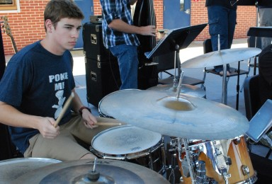 Senior Patrick Furino performs in the school commons area with members of the jazz band.