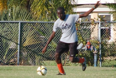 Kicking the ball, freshman Amaefule Chukwunenye prepares for his next game.