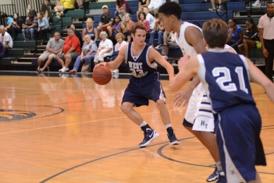 Junior Chris Mikulas takes a retreat dribble in a game against Holy Trinity