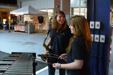 During Festivus, seniors Jennifer Stone and Paige Neihart prepare for the jazz band performance.