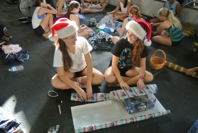 Happy to help, senior Michelle Smith and junior Erin Sheridan wrap gifts for needy children.