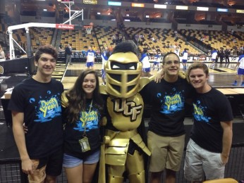 Attending+UCF%27s+homecoming+basketball+game%2C+seniors+Randy+Slomin%2C+Vinny+Guglietta%2C+Shaun+Wilson%2C+and+Lindsay+Gorham+encounter+the+Knights%27+mascot.