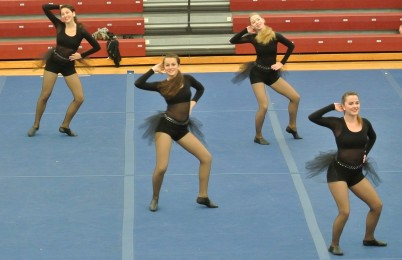 Varsity+members+Keiran+Sheridan%2C+Hope+Daughtry%2C+Erin+Sheridan%2C+and+Brady+Kelsey+perform+in+a+December+dance+competition.+