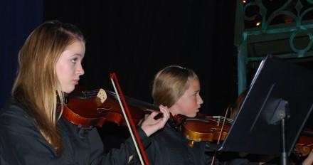 At the December 2012 concert, sophomore Orchestra members watch teacher Maureen Fallon conduct.