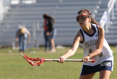 Senior Paula Kostro works on her stick work.