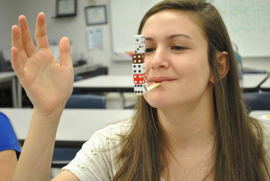 Preparing to film a WCTZ commercial for Minute to Win It, junior Alyssa Gorewitz practices Minute to Win It games.