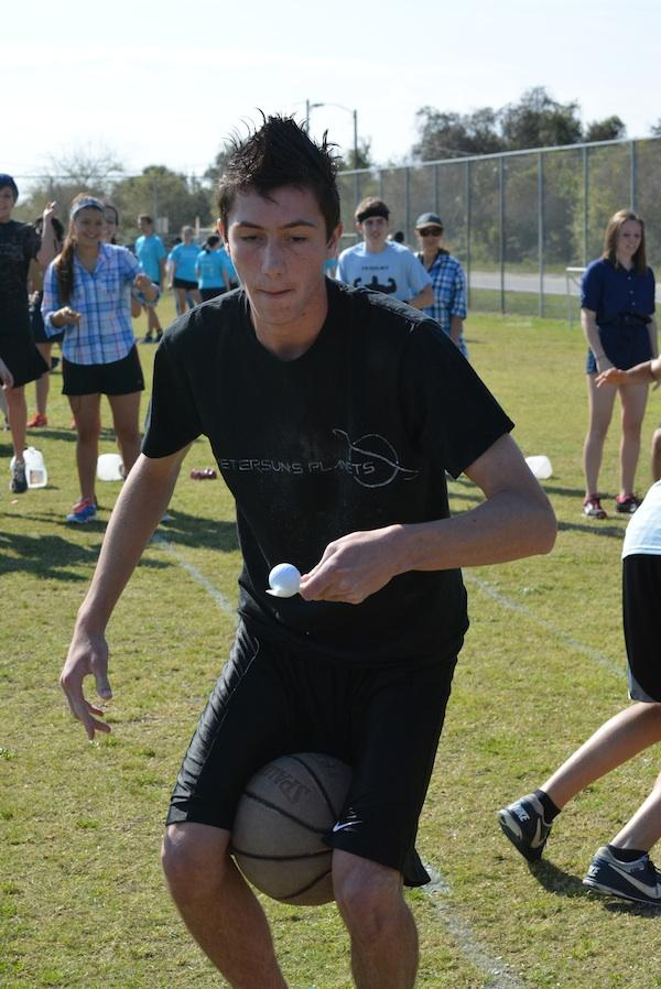 In one of the field games, junior Joe Along carries a basketball and an egg.