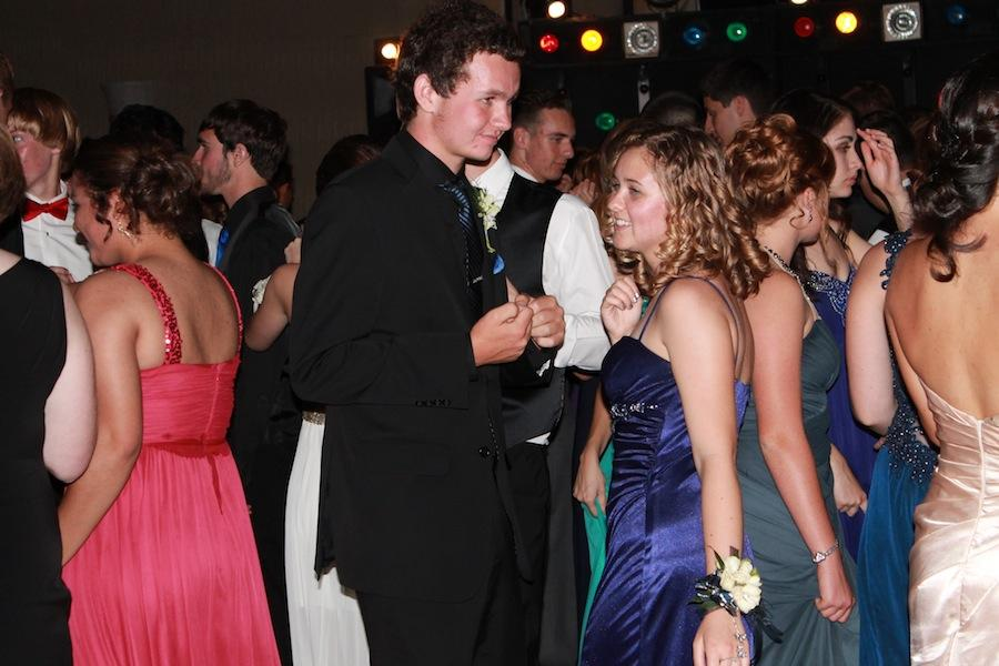 All dressed up, juniors Gabrielle Jefferson and Robert Breninger dance together.