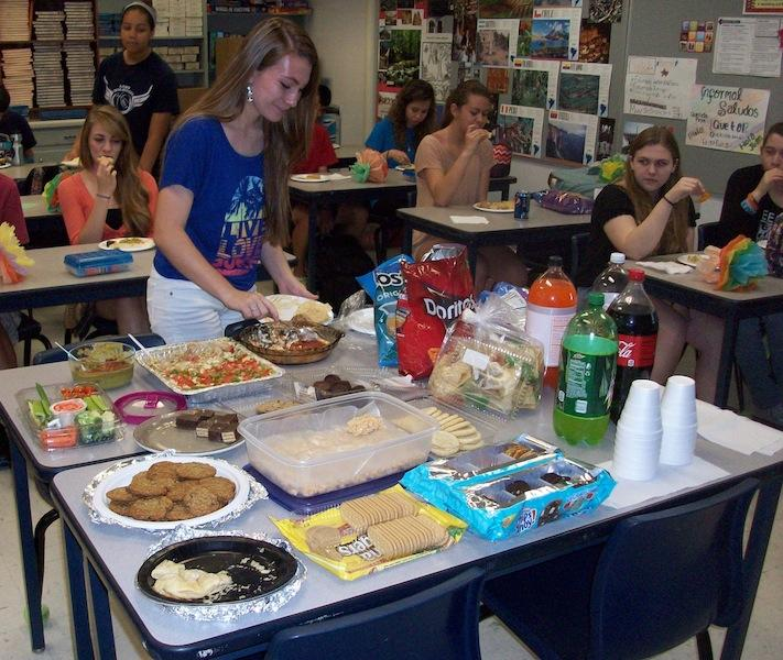In+celebration+of+Cinco+de+Mayo%2C+sophomore+Adrianna+Green+scoops+up+hummus+during+second+period+Spanish.