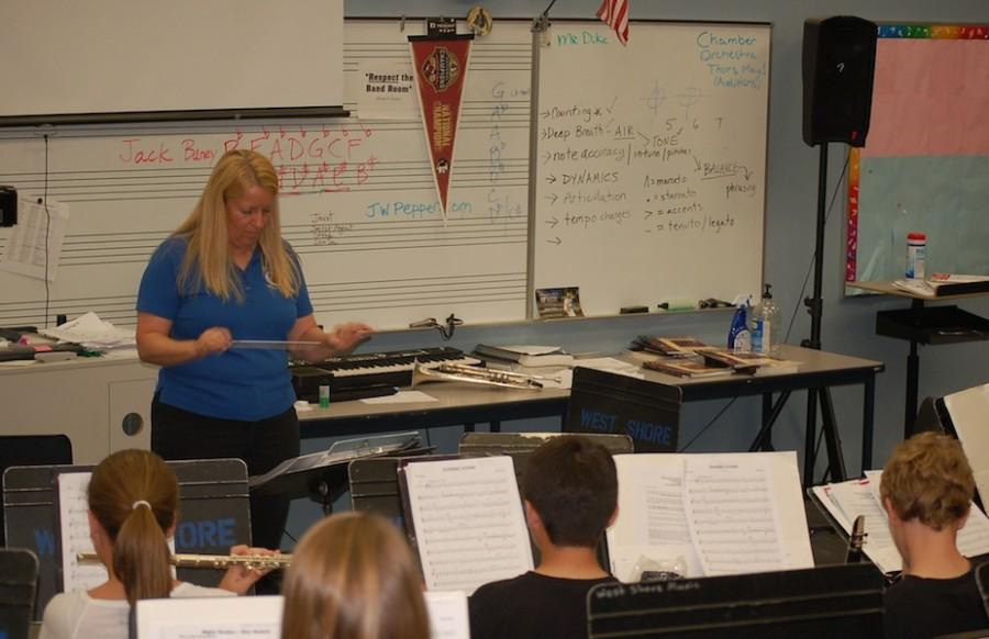 The day before the concert, band teacher Carol Allen rehearses with her beginning band one last time.