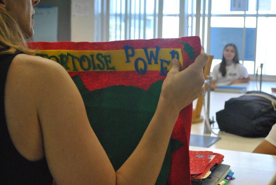Science teacher Angela Feldbush displays her flag during a home-room meeting.