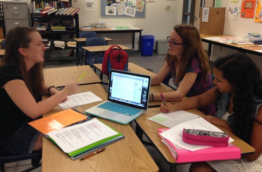 Senior Mary-Elizabeth Jobson, junior Georgia Reis and junior Margarita Cruz-Sanchez discuss upcoming events.