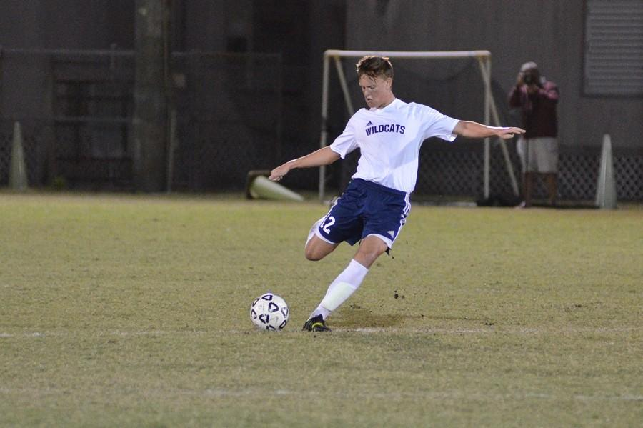 Sophomore+defender+Nick+Burgess++passes+the+ball.