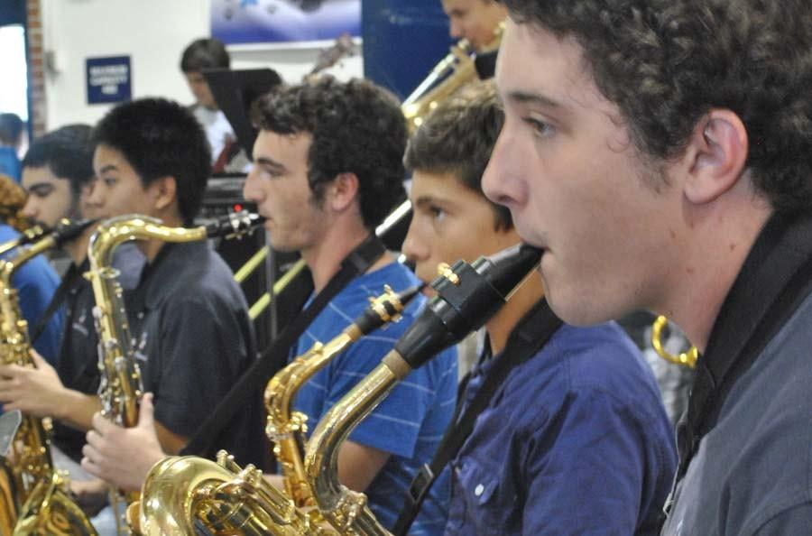 Junior Mark Spurlock performs at a fall pep rally.
