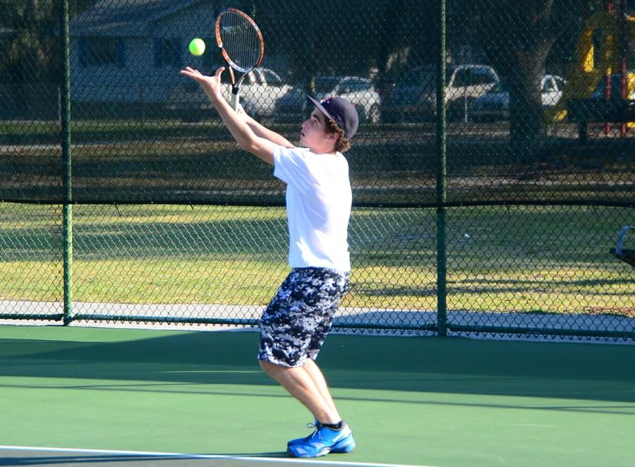 Junior Evan Cooper serves against Rockledge.