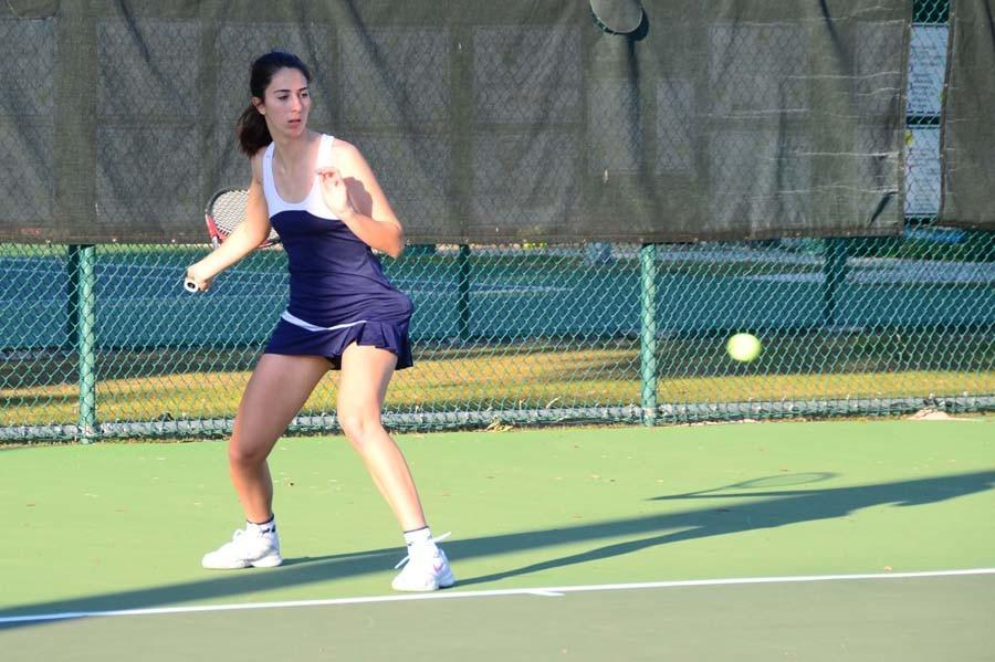 Senior Ashley Pekmezian returns a serve.