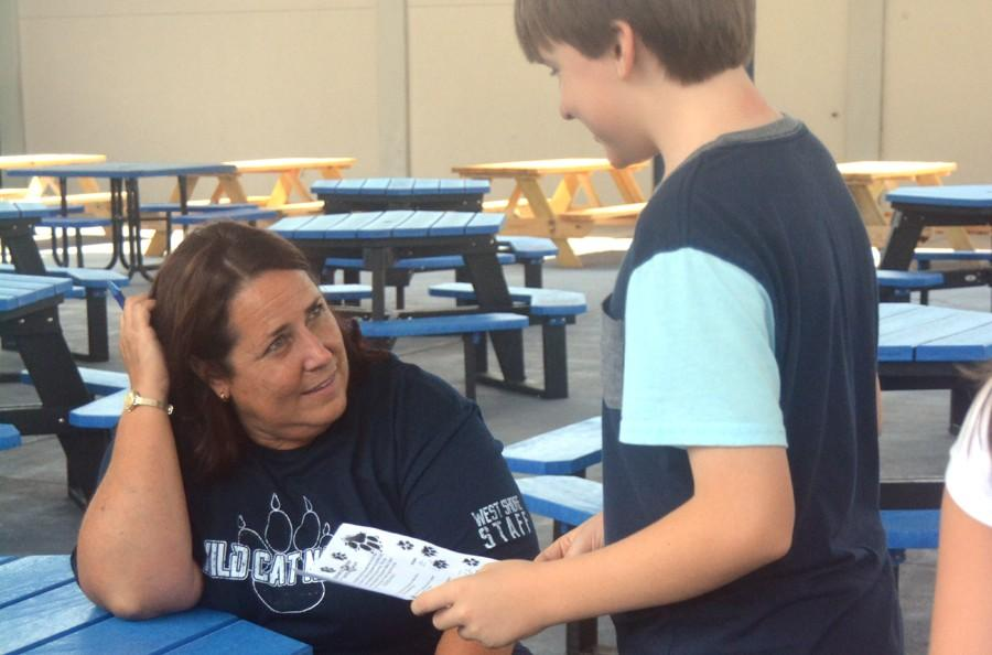 Assistant Principal Catherine Halbuer helps a seventh-grader during the annual first-week scavenger hunt.