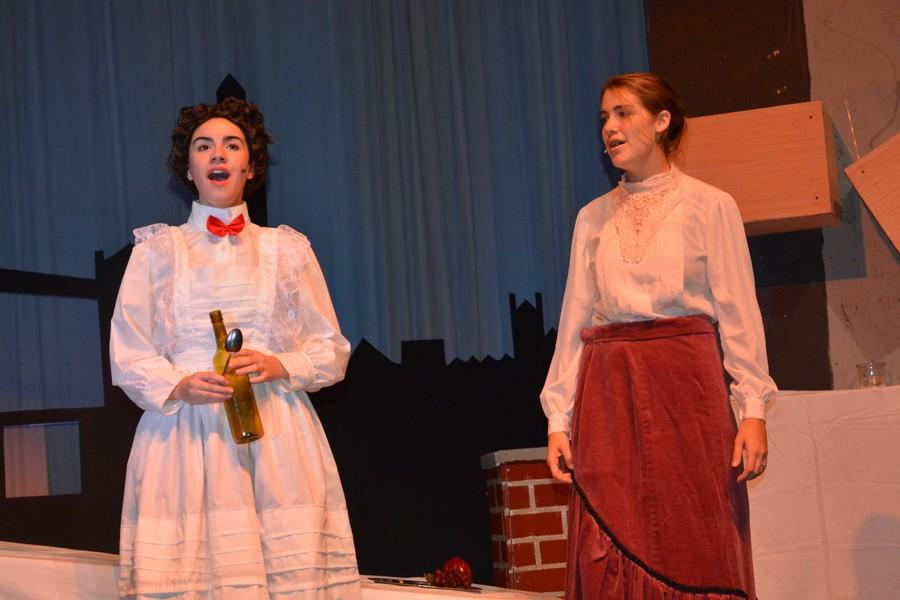 """Senior Kaylee Willner (Mary Poppins) and junior Emily Browne (Winifred Banks) perform """"A Spoonful of Sugar."""""""