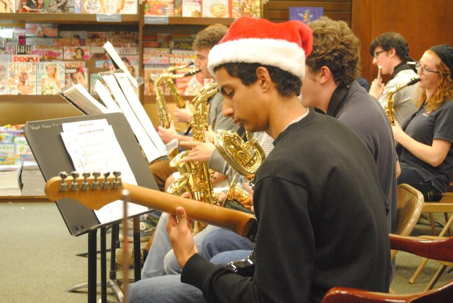 Senior Samuel Mikhail plays guitar at years Barnes and Noble Night.