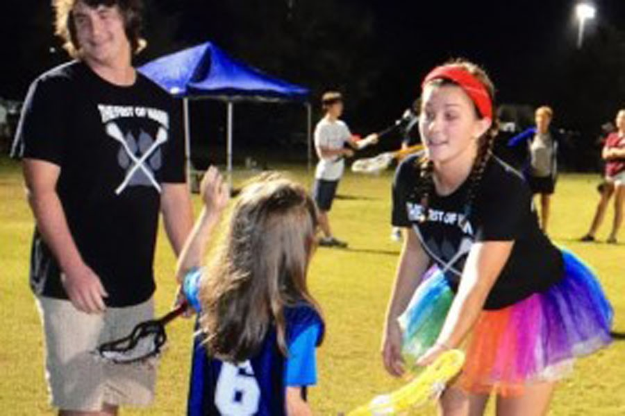 Taylor Canavan teaches children with intellectual disabilities how to play lacrosse.