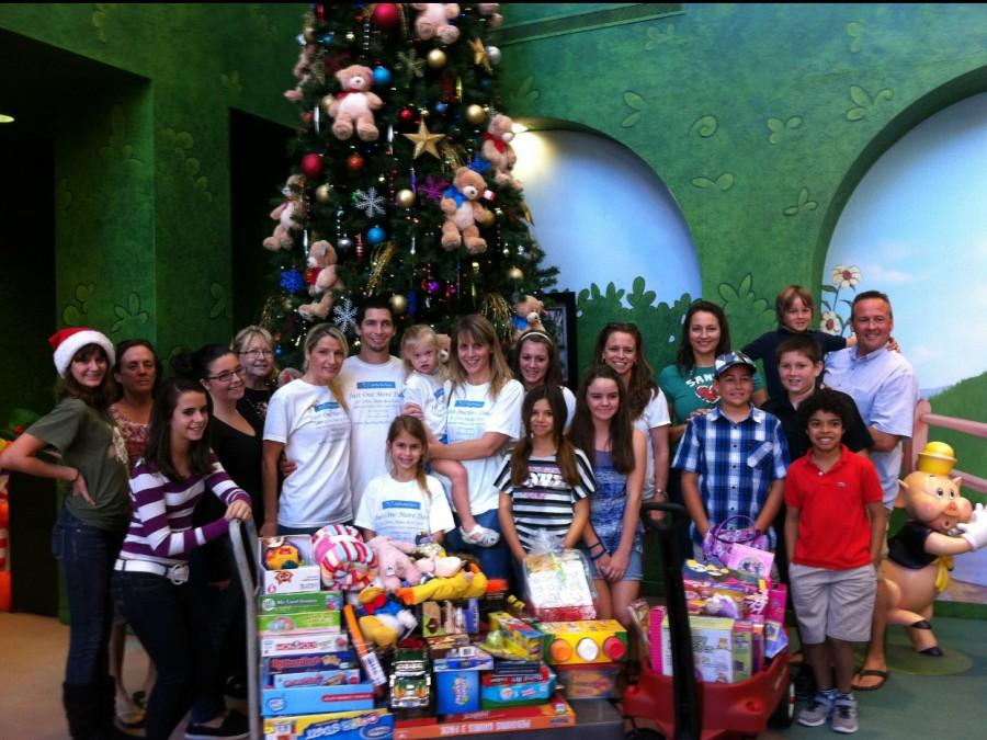 Delivering toys to children in hospitals, Allie Henderson and her group of volunteers help families with sick children during the holidays.