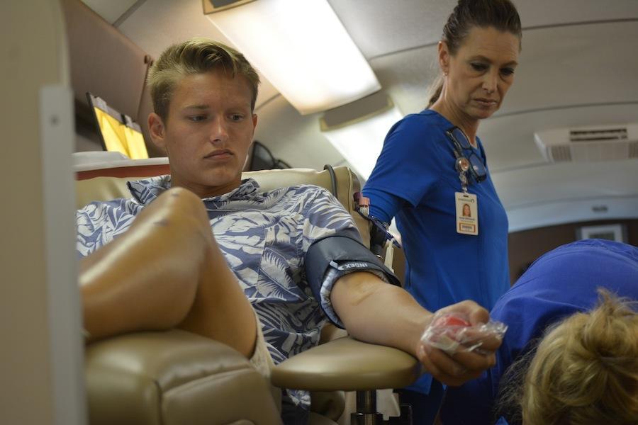 Senior William Lemstrom donates blood at school on Nov. 10.