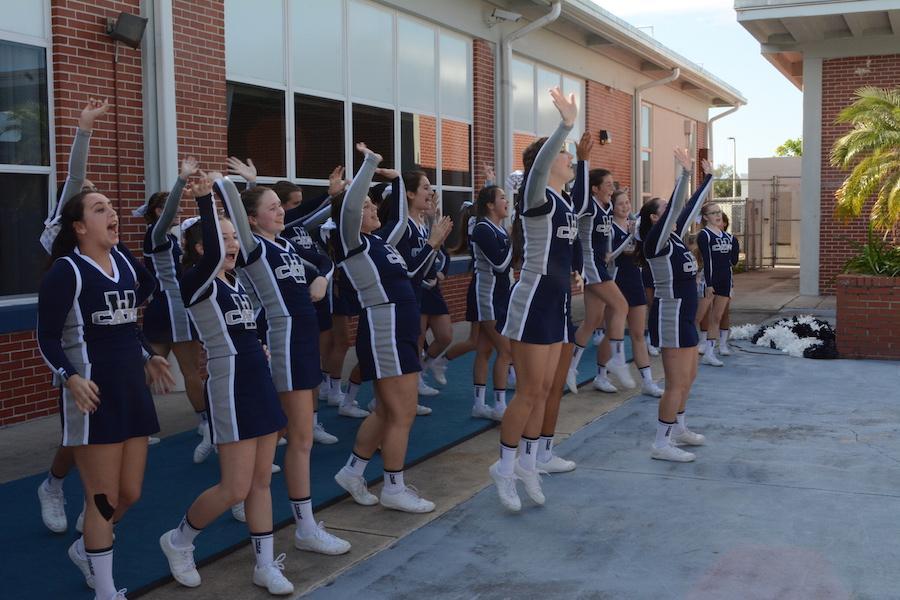 Ending their performance, the cheerleading team spirits on the school.