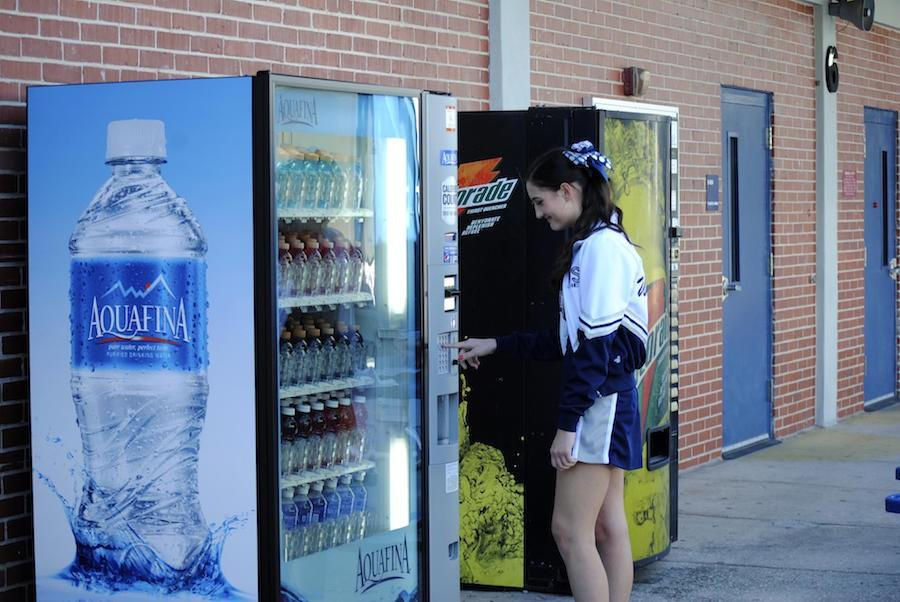 Waiting for her ride home after school, junior Briana Sandoval purchases a gatorade from the water vending machine.