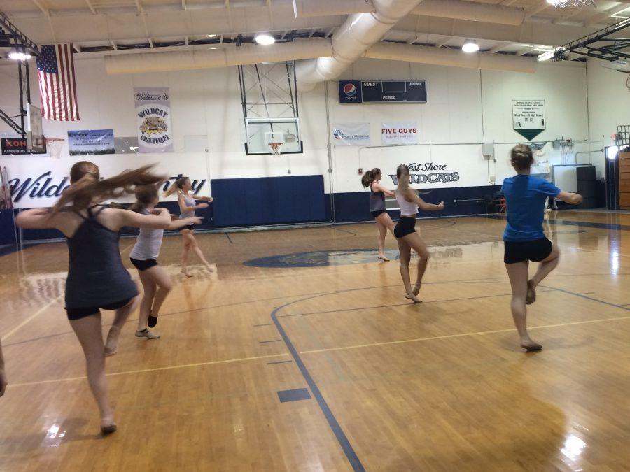 Turning+across+the+floor%2C+dance+team+members+advance+their+technique+skills.