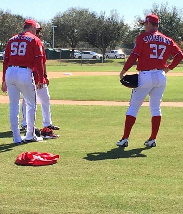 Practicing at Space Coast Stadium in April, Washington Nationals players Stephen Strasburg and Jonathan Palpebon gear up for the season.