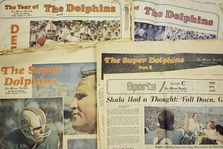 """Original copies of the """"Miami Herald"""" from 1972 and 1973 about the Miami Dolphins being Super Bowl champs."""