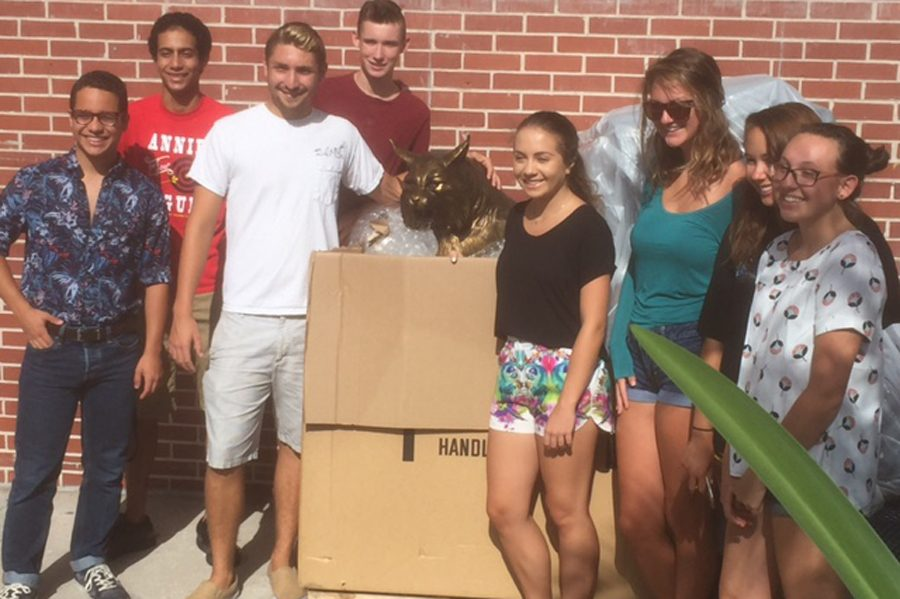 Members of the Senior Class of 2016 get a sneak preview of the new wildcat statue in early August.
