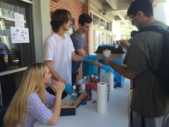 After school, juniors Jerry Sola, Gianni Valenti and Joanae Lawrence sell snow cones.