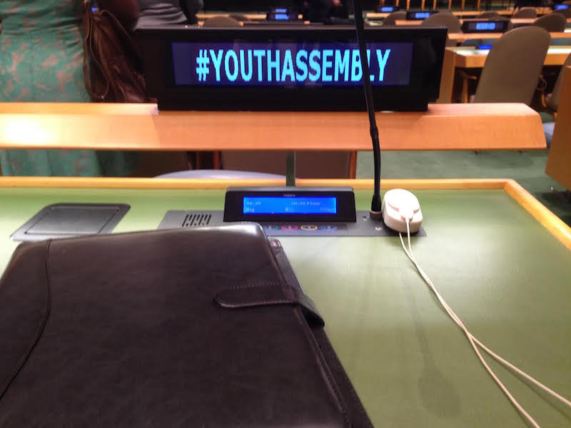 Attending+the+United+Nations+Youth+Assembly%2C+senior+Nina+Fusco+snaps+a+picture+of+her+desk+area.