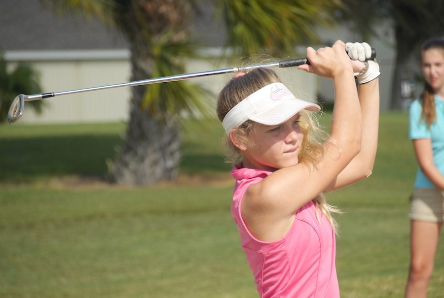 Freshman Greta Golf watches her drive Tuesday afternoon.