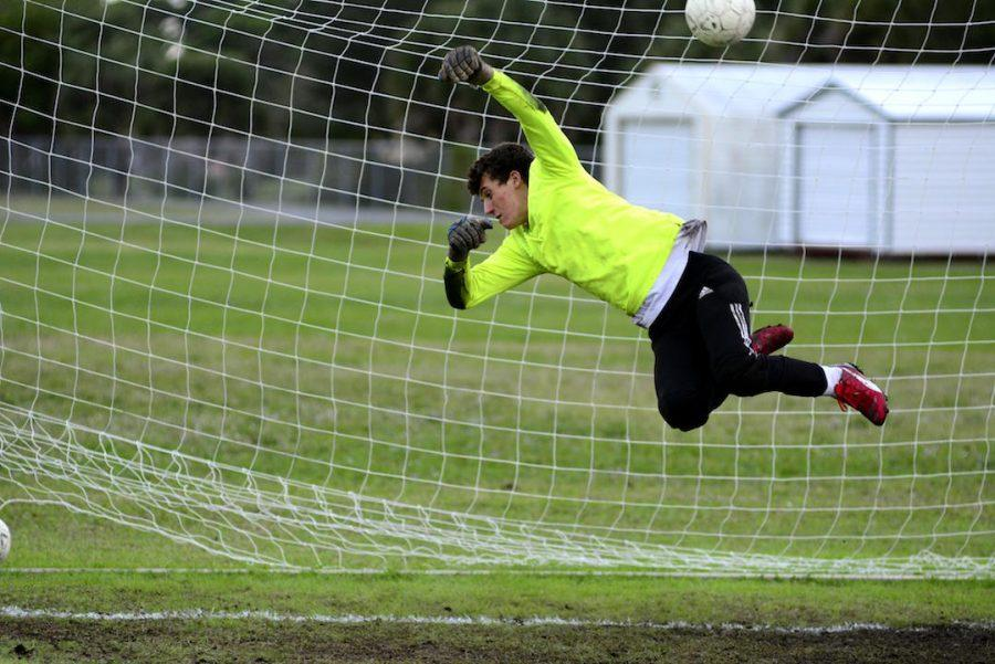 Goalkeeper+Luke+Whitworth+dives+to+save+a+shot+on+goal+at+a+game+during+the+2015-16+season.+