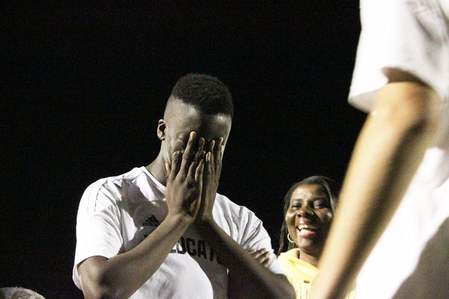 Senior Amugo Chuckwunenye reacts to being honored during Senior Night on Friday.