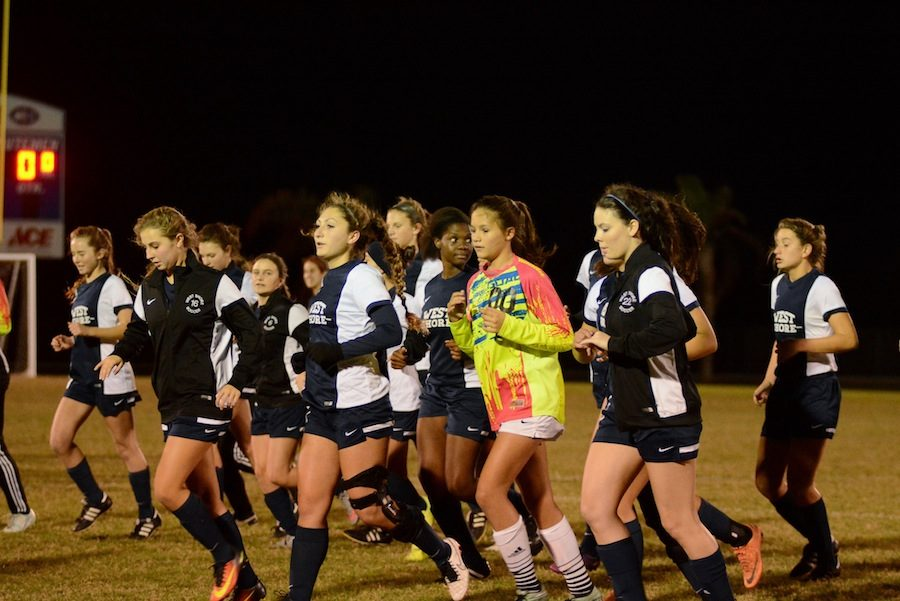 The+girls%27+varsity+soccer+team+will+play+for+the+district+crown+tonight.