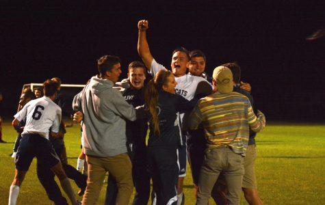 Senior Nick Burgess celebrates with Wildcat students.