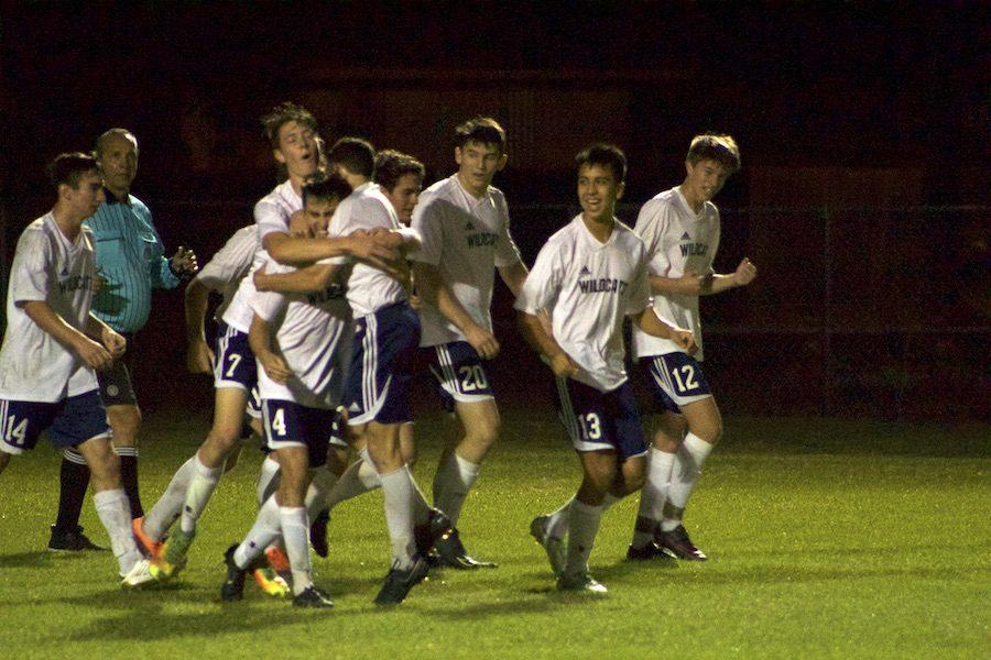 The team celebrates after junior Abe Murphy scores his second goal in Saturday's regional semifinal.