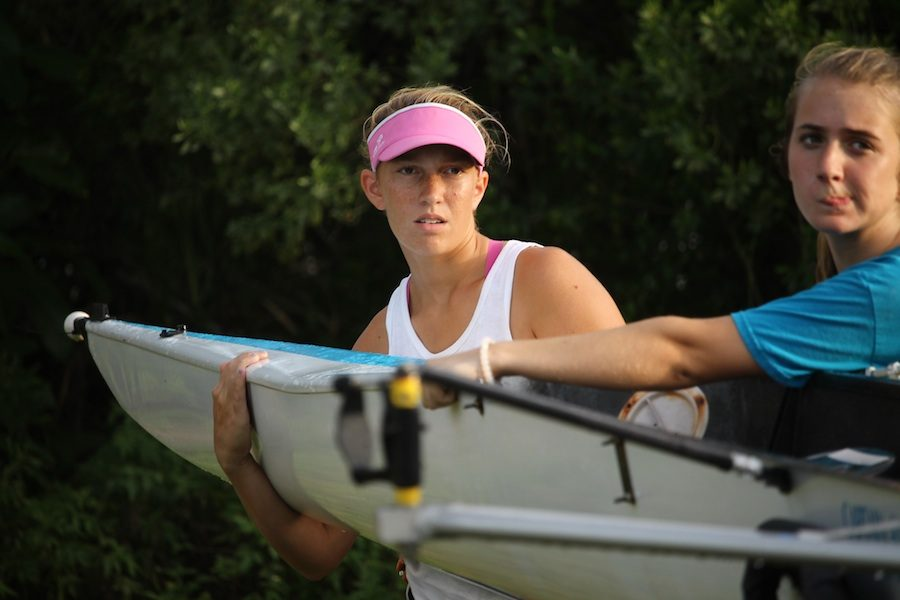 Junior Marissa Scalise prepares a rowing scull for an afternoon on the water.